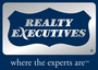 REALTY EXECUTIVES COMPLETE PROPERTIES INC. real estate logo