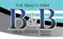 THE REALTY FIRM INC. (WOODSTOCK) real estate logo